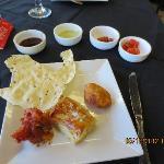 Pappadum, chutneys, pickles, veggie puff, pazhampori