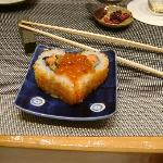 Salmon and cucumber sushi with red salmon eggs on top