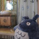 room with a huge totoro