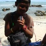 local boy selling wares on beach