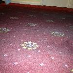 Thick layer of dust on carpet under bed