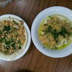 Two Hummus dishes, one with pine nuts and the other with foul