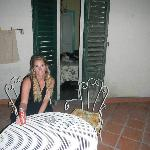 My wife enjoying our table outside the room