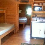 Living area standing in front of door facing kitchenette
