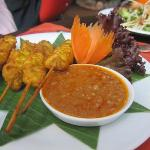 Sa Ta Thin chicken skewers marinated and grilled served with a peanut sauce)