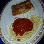 Pizza bolognese and spaghettis bolognese