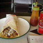Chicken burrito with cola and hot sauce