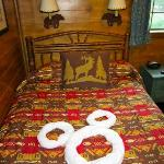 Cute towel art on the camping themed bed.