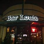 nighttime at a busy bar louie