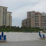 Hotel is tall bldg on the left (villas are on the right). View from the beach.