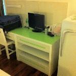 Small TV, fridge and bigger desk