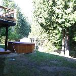 View of deck and hot tub overlooking garden from dining room