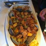 Clams and pork with potatoes and olives.