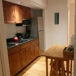 Kitchen with very small eat/work table with 2 stools