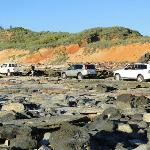 4x4 vehicles heading north over the rocks