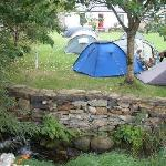 Campers on our camping lawn, enjoying the soothing sounds of the Mill stream
