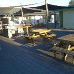 Common outdoor sitting area near communal kitchen