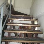 Staircase to swimming pool.. So much junk under the staircase. Fire Hazard.