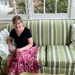 My wife on the couch in the sunroom at The King's Daughters Inn