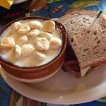 Cup of Seafood Chowder and half of a roast beef sandwich.