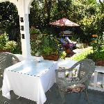 Enjoy a full breakfast on the veranda overlooking the gardens