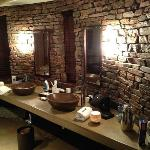 The backside of our suite featuring 2 separated wasbasins and a brick wall...