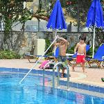Nikolas & Panagiotis Helping the Pool Man