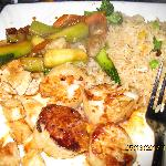 Fried rice, chicken, scallops and vegetables.