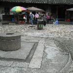 a coin-shaped well