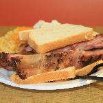 Beef rib sandwich.  A little tug pulls the meat off the bone for you to pile on the bread.