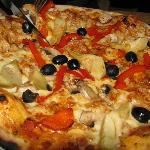 4 seasons pizza: artichokes, black olives, red pepper and champinions