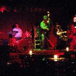 Blues jam, four piece band plus guest horn player