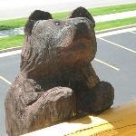 Wooden Bear looking in our window from inside hotel