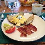 Full breakfast, along with fresh fruit and freshly baked croissants