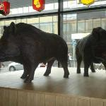 Statues of wild boars inside the Villisika restaurant