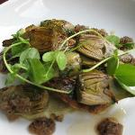 Tasty pan fried sea bass with artichokes