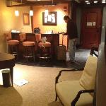 the living room and bar in a one room suite