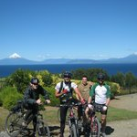 Bikers with Osorno vulcan and Llanguihue lake