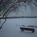 A quiet dusk on the lake, with snow falling.