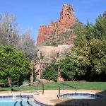 Outside dining area  with pool, hot tub and red rock view