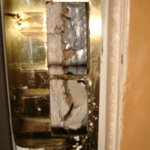 Unrepaired door jamb damaged from kick-in