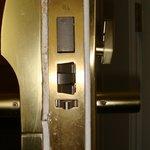 Unrepaired door damaged from kick-in