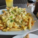 Pappas fritas,poissons et crevettes dans une sauce au curry,Miam  . . .