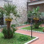 Garden courtyard of palazzo where B&B Le Torri is located