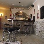The quaint bar setting.