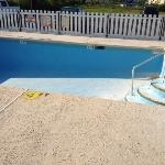 "Empty, cracked pool under ""renovation""."