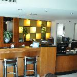 Front desk and bar in hotel lobby.