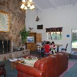 Sitting/breakfast area with TV and fire place.