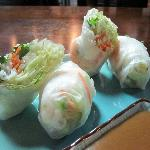 fresh spring roll appetizer – two rolls filled with shrimp and crisp vegetables all wrapped in c