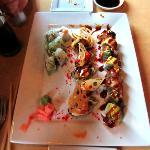Three Sushi Rolls: Philadelphia Roll, Dragon Roll, and the Takanami Dynamite